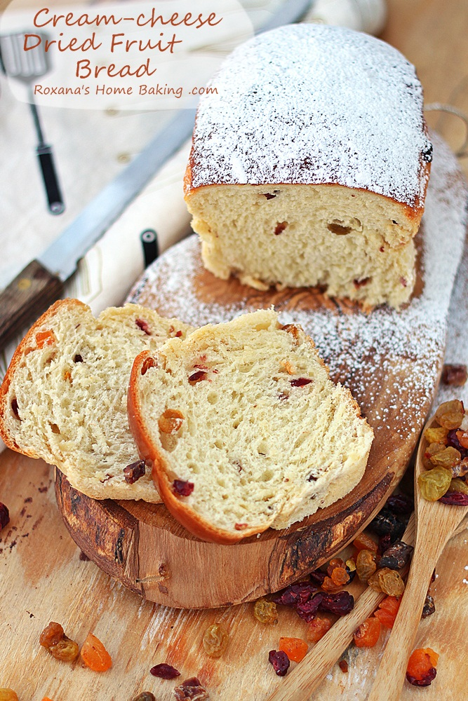 Sweet, soft and fluffy yeast dried fruit bread made with cream cheese and dusted with powder sugar for Christmas breakfast or brunch