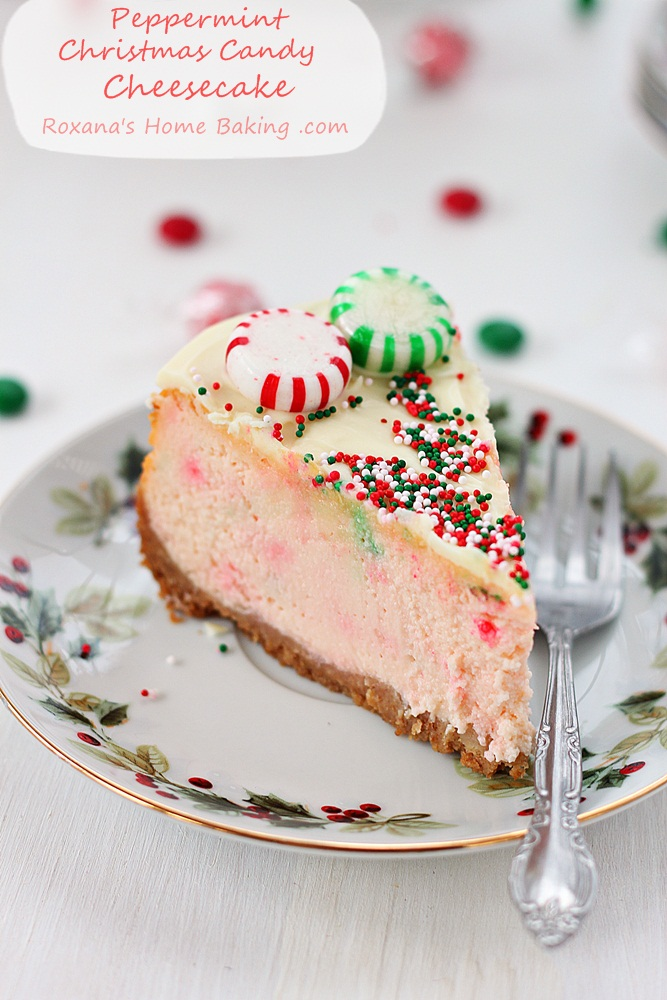Velvety ricotta cheesecake mixed with crushed peppermint candy and topped with a layer of white chocolate ganache, Christmas candy and sprinkles.
