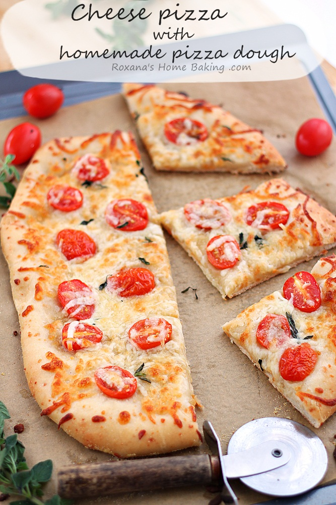 Made-from-scratch flavorful cheese pizza dough topped with more cheese and grape tomatoes. Friday night pizza just got a whole lot better! Recipe from Roxanashomebaking.com