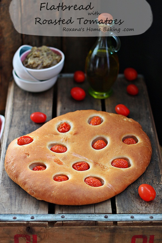 Flatbread with roasted tomatoes - easy to make and full of flavor from the tomatoes which are roasting while the bread bakes.