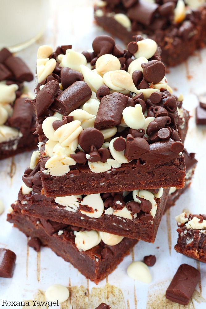 Chocolate cookie base, fudge and 2 cups of chocolate chips - these over the top chocolate chip bars are a chocolate lover dream come true!