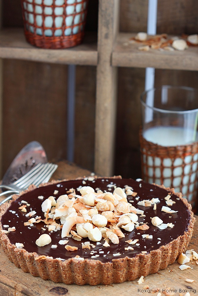 Chocolate ganache coconut tart  - flaky almond tart crust filled with silky, decadent chocolate coconut ganache.