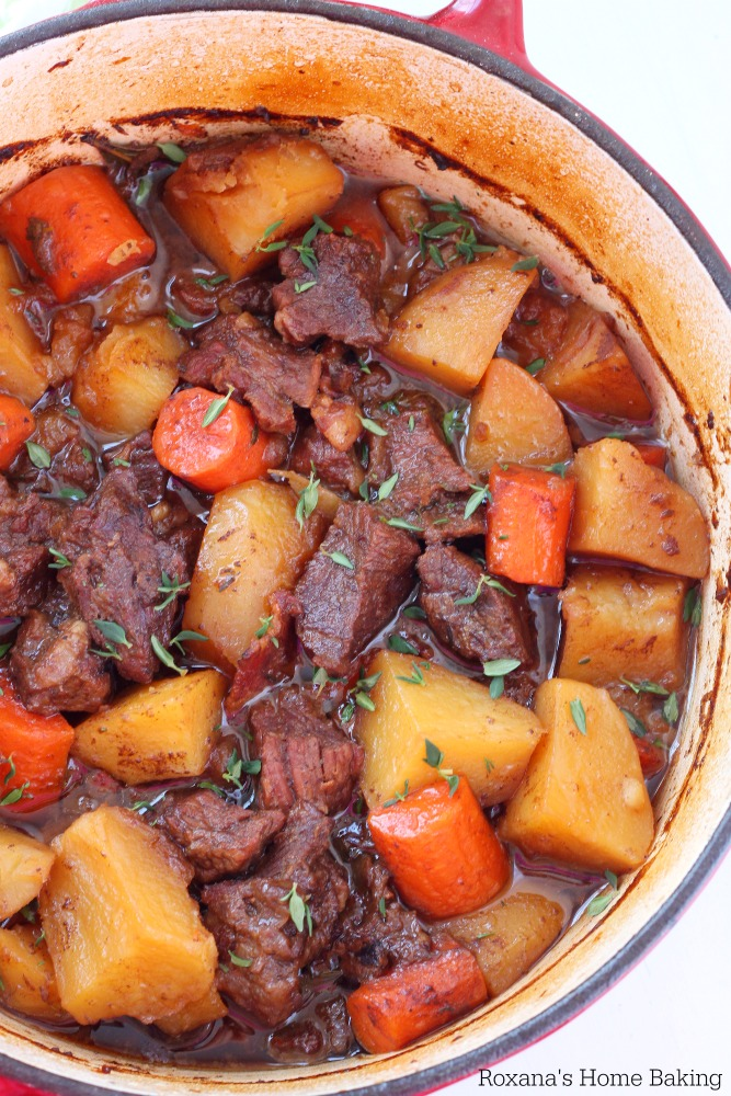 Flavorful beer braised beef with carrots and potatoes, cooked slow and low in the oven is an effortless weeknight meal. One bite of this tender, juicy, tad spicy beef is going to send you over the moon