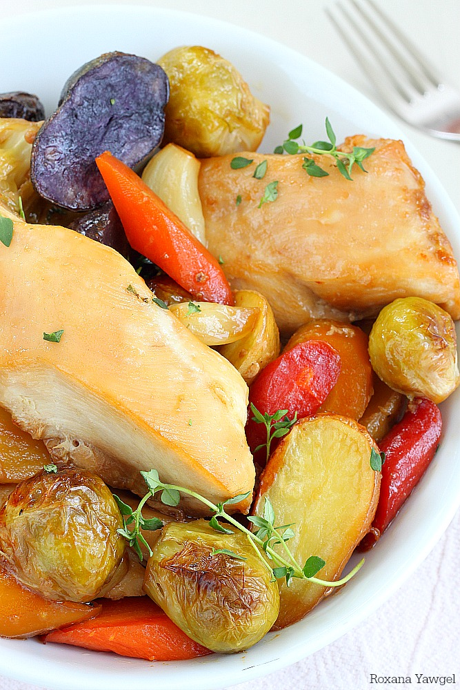 Tender chicken baked with a rainbow of vegetables - potatoes, carrots and Brussels sprouts in one single pan! Only 10 minutes of prep time to make this roasted chicken and vegetables dinner!