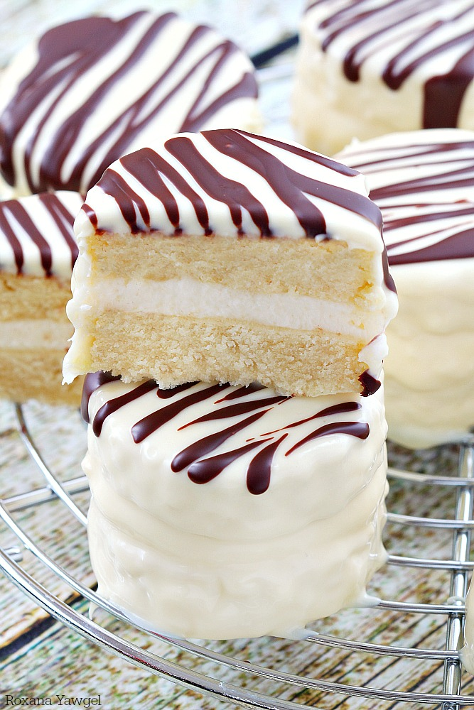 Infused with vanilla flavor and coated in white chocolate with dark chocolate stripes, these made from scratch copycat zebra cakes are dangerously good!