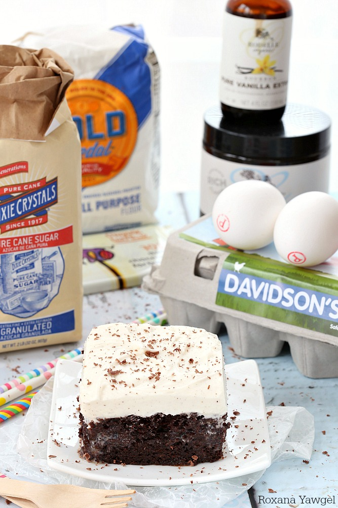 A delicious made from scratch double chocolate poke cake soaked with vanilla bean milk and topped with a generous amount of vanilla bean frosting! Chocolate and vanilla lovers will go crazy over this cake!