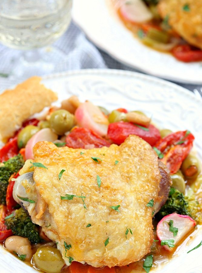 Flavorful and delicious, this one pot chicken thighs and fresh vegetables is made with simple ingredients to create a meal that kids and adults will love.