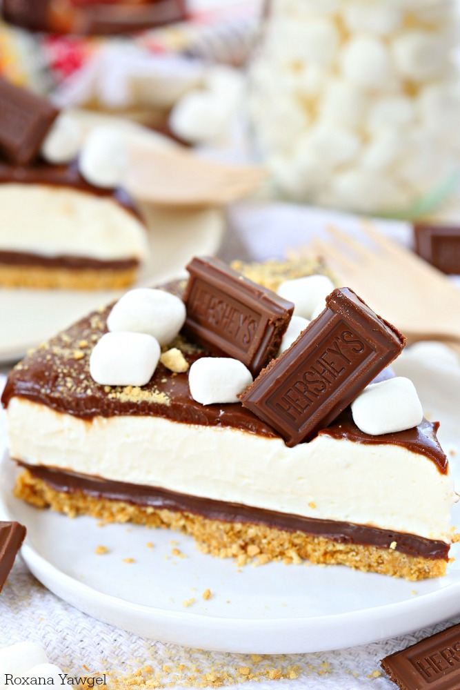 Easy to make no bake smores cheesecake features layers of decadent buttery crust, rich chocolate ganache, airy marshmallow cheesecake filling and a second layer of chocolate ganache. One bite and you're in love!