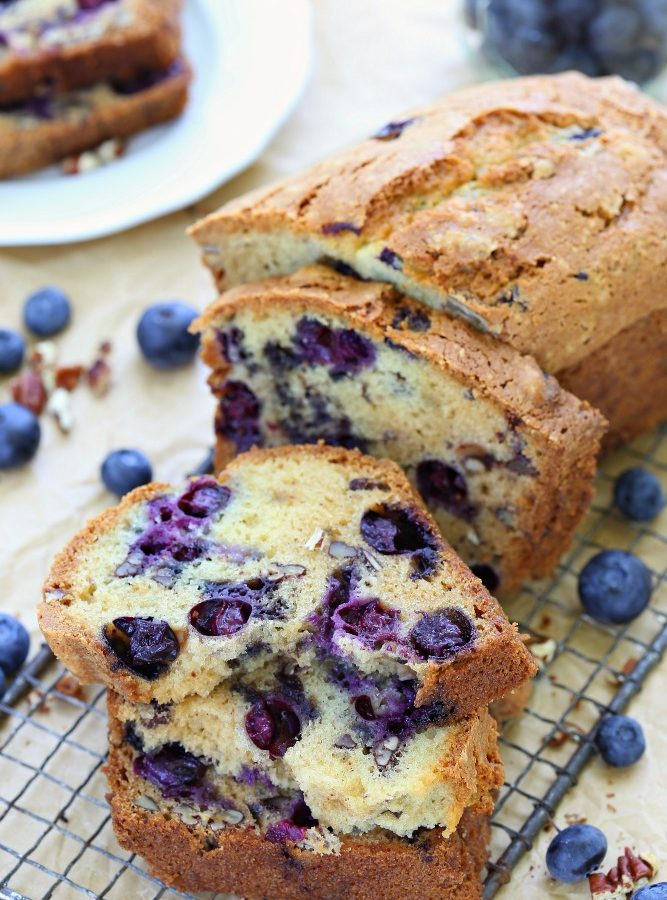 No mixer needed to make this incredibly soft blueberry bread loaded with fresh blueberries and crunchy pecans. Perfect to snack on along with a cup of coffee or tea.