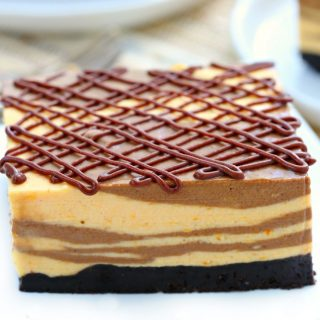 A cheesecake that crossed paths with a pumpkin pie, these marble no bake chocolate pumpkin cheesecake bars feature layers of creamy pumpkin and rich chocolate all infused with just the right amount of pumpkin spice!
