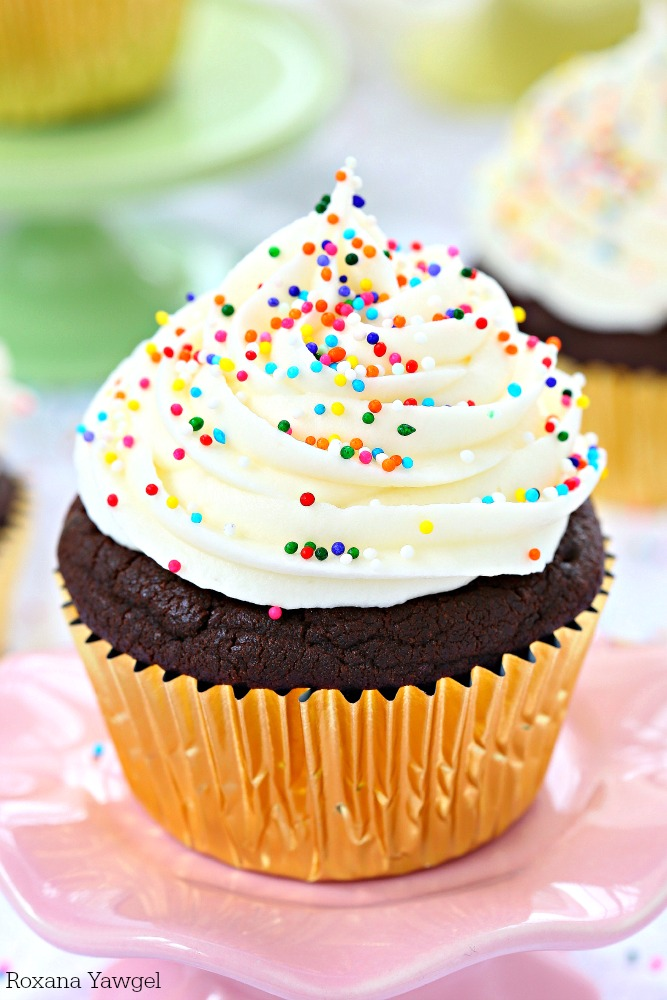 So soft, fluffy, and full of chocolate flavor in every bite, these sugar cookie chocolate cupcakes are piled high with cream cheese frosting and finished with colorful sprinkles!