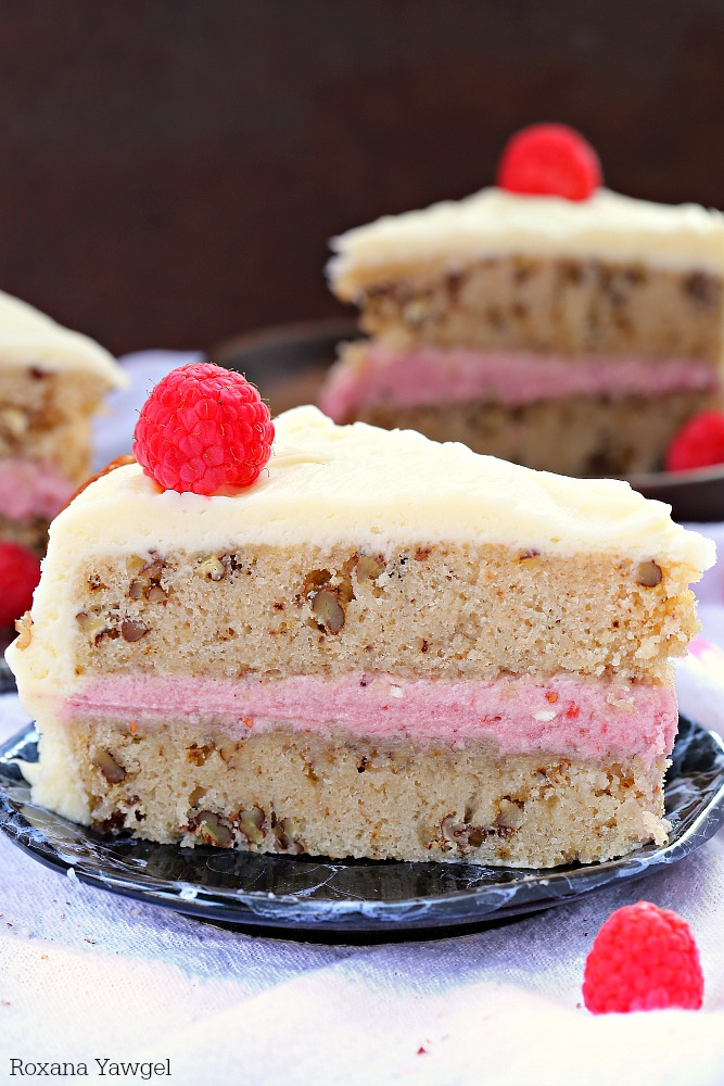 Incredibly moist, tender and delicious this white chocolate pecan cake has a subtle white chocolate flavor and crunchy pecans in every bite. The raspberry white chocolate frosting is rich, creamy and delicious. One bite and you can't stop!