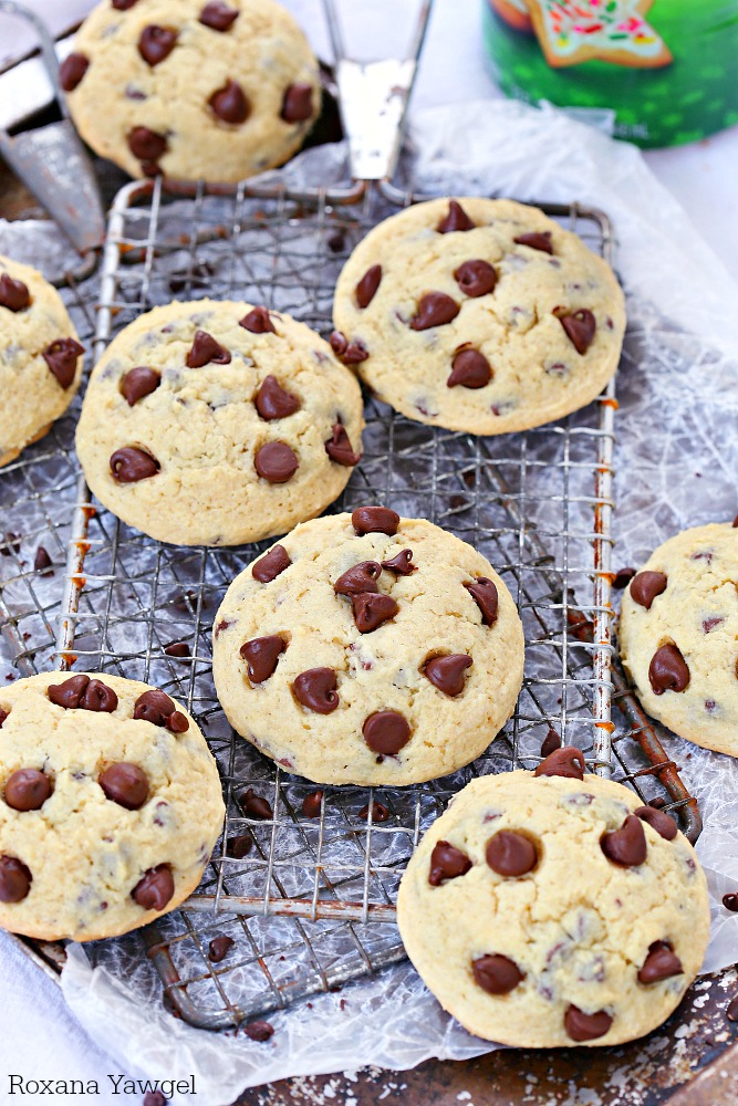 Happiness is a plate of these soft chocolate chip sugar cookies right out of the oven! Loaded with mini chocolate chips and dotted with more chocolate chips on top these cookies are a favorite treat! No chilling required!