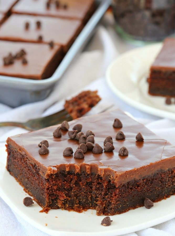 Enjoy this irresistibly rich and creamy chocolate cake topped with a delicious fudgy warm chocolate frosting.